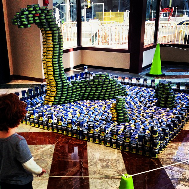 Something in the air, perhaps:  a sea monster made of cans!  #patronsaintplay #canstruction #cityharvest